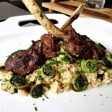 Frenched venison rack with mushroom risotto and sautéed fiddleheads