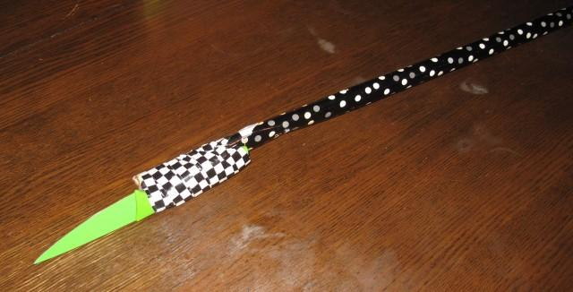 A kitchen knife taped onto the broom handle