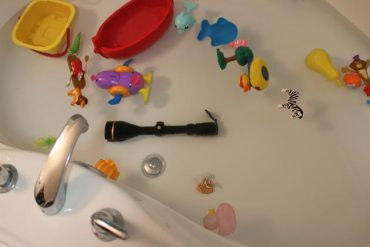 Bath tub filled with toys and a scope