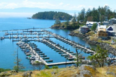 Fishing boats moored at Cheanuh Marina on the Sc'ianew (Beecher Bay) First Nation Reserve in East Sooke May 2019