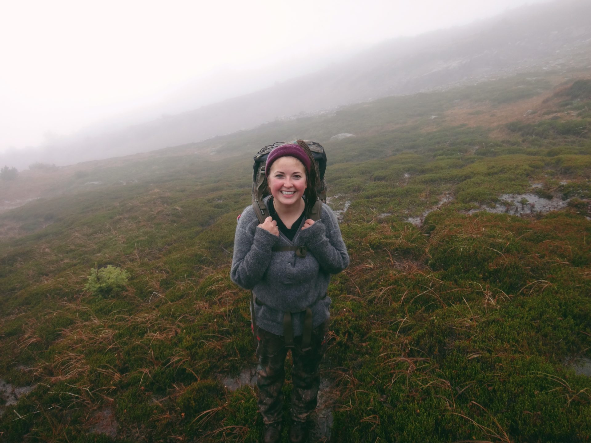 Despite the rain and fog, I was all smiles at the top of the mountain.
