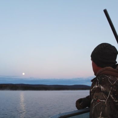 Up with the moon, crossing Ootsa Lake in the pursuit of moose.