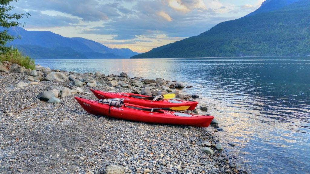 Kayaks stand at the ready on Slocan Lake.