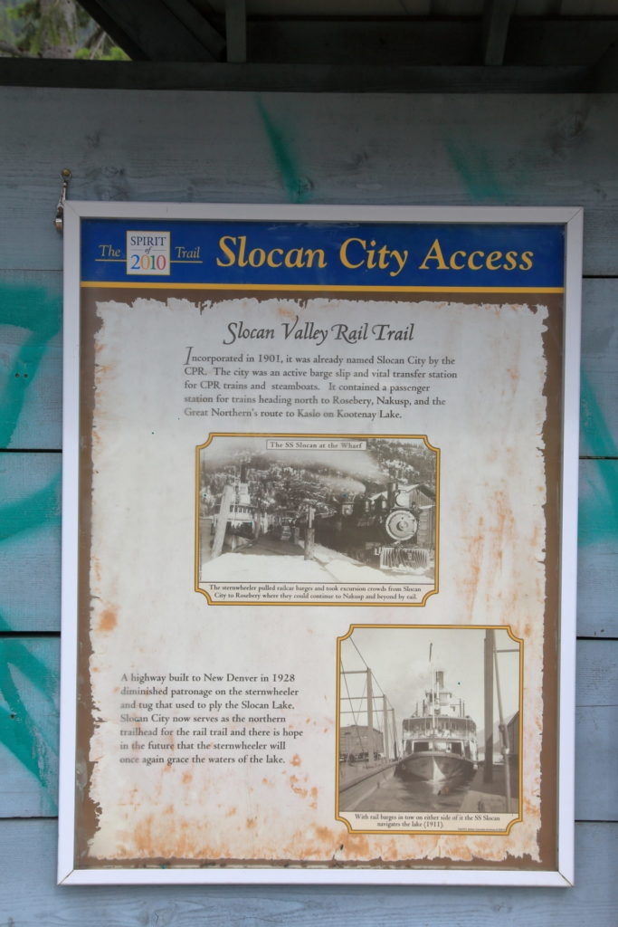 A sign telling the history of the Slocan Valley Rail Trail. The Slocan Valley Rail Trail Society took over stewardship of the right-of-way in 1994.