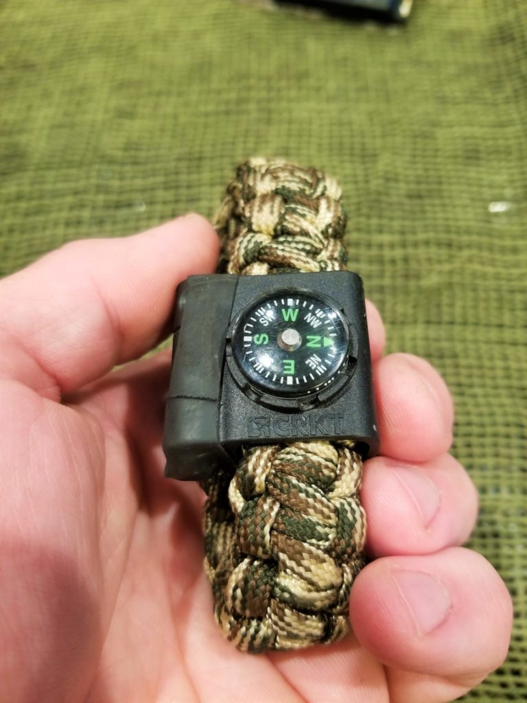 A button compass is a good back up, as long as you make sure to hold it level.