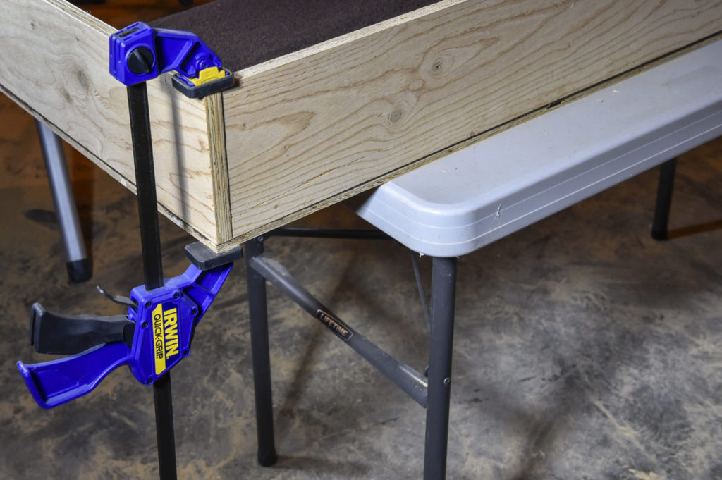 6.A clamp secures pieces to assemble a tight box joint, as on this drawer.