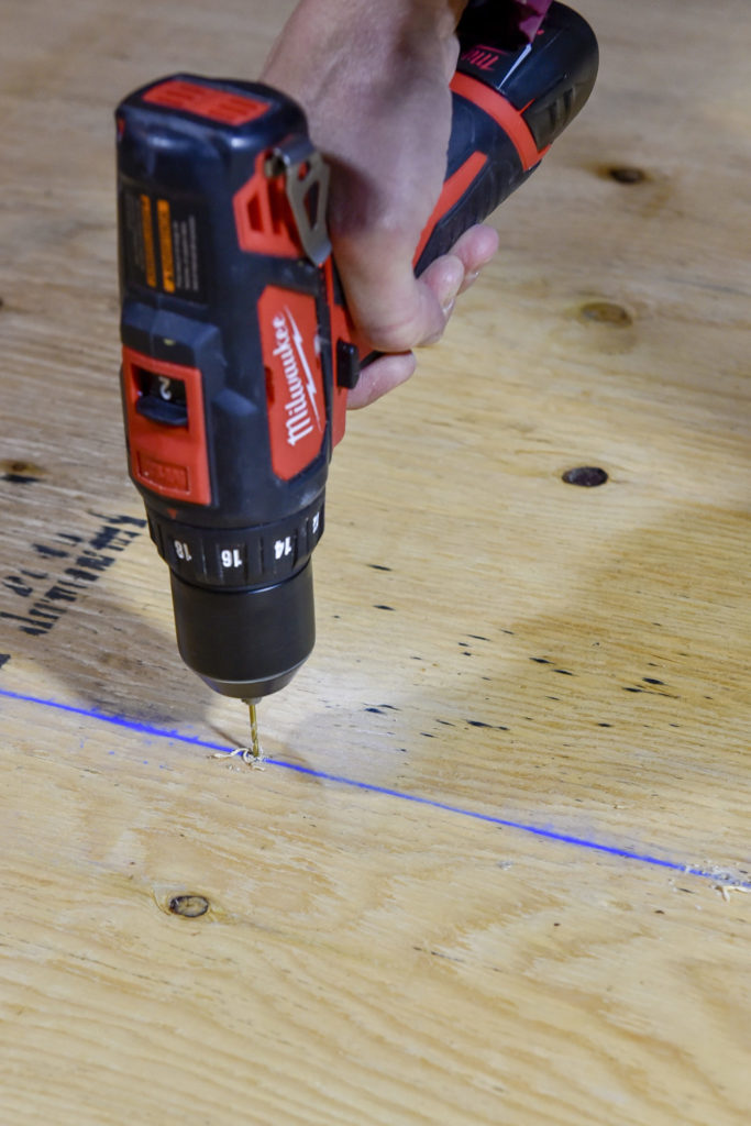 4.Screw holes were marked and pre-drilled to prevent splitting the wood.