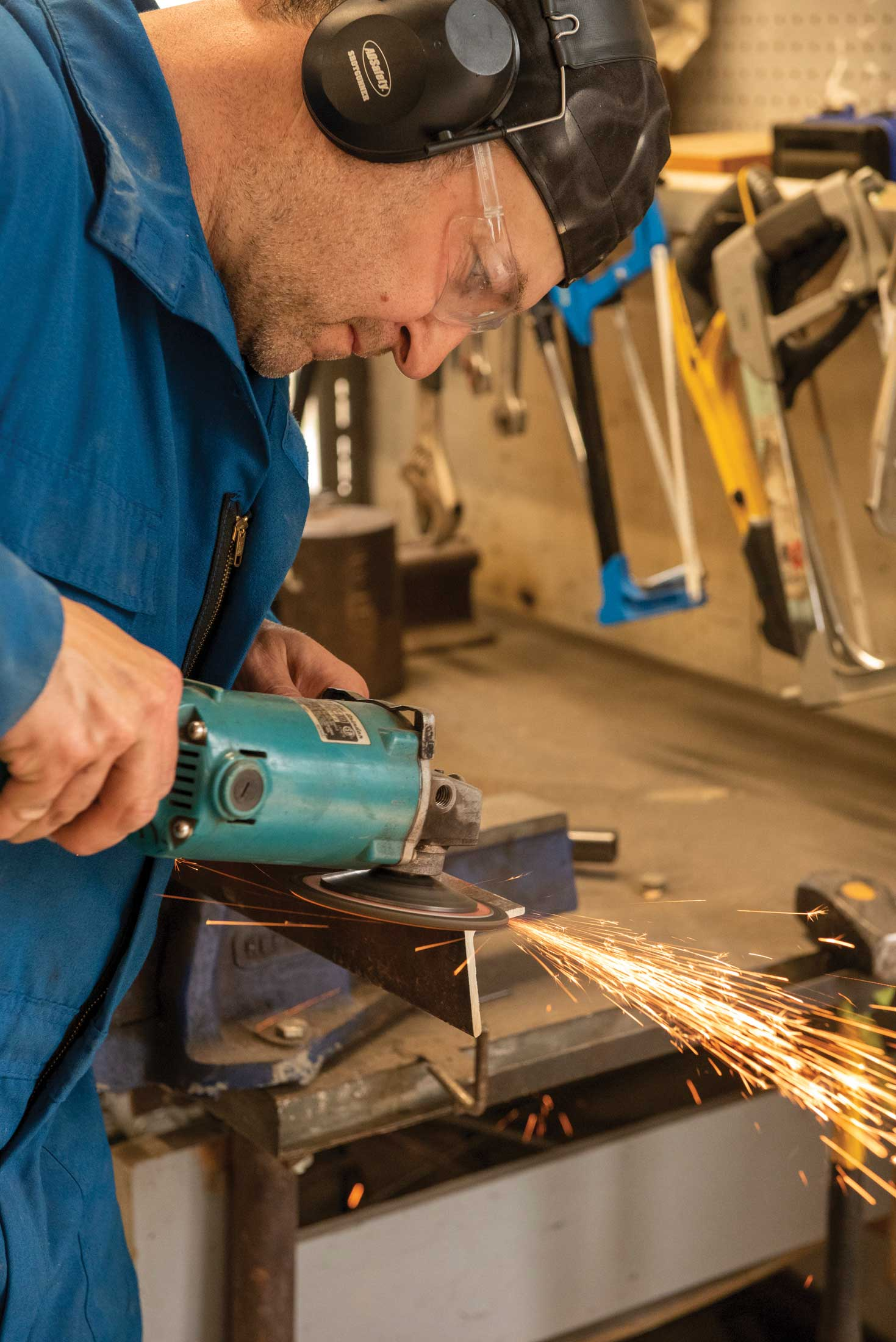Step 4, metal preparation: Good metal preparation is crucial to good welds, especially when using recycled metal. Here, a wire brush on an angle grinder removes old paint and rust.