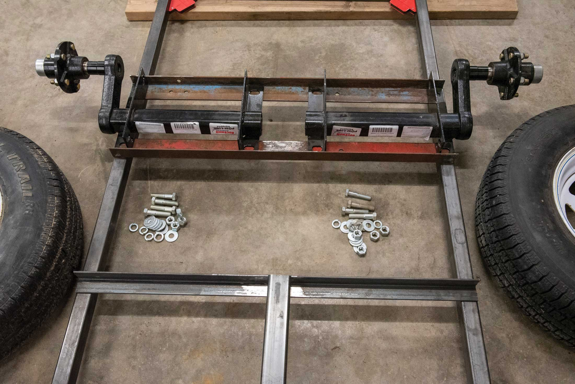 Step 7, assembly: The axel assemblies were bolted onto the frame supports, followed by tire installation.