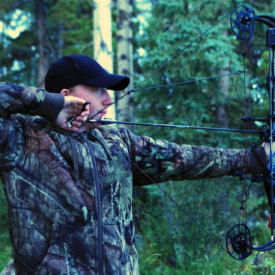 Man bow hunting