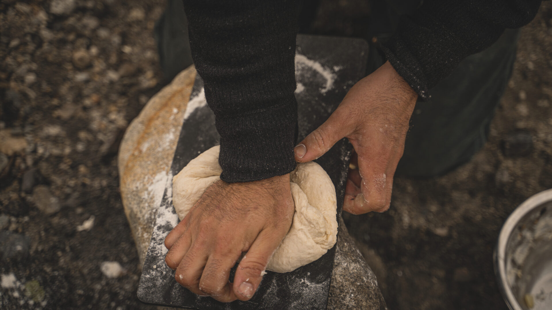 Fireside focaccia bread is no easy task, but the results are worth it. Photo by Cody Preston @codywpreston.